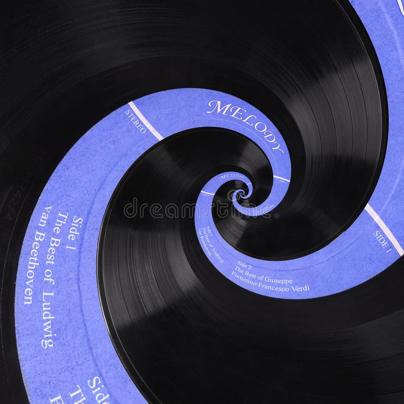 Abstract music vinyl disc spiral fractal background. Retro music vinyl disc abstract fractal. Vintage musical conceptual image. Pattern background Repetitive stock photo