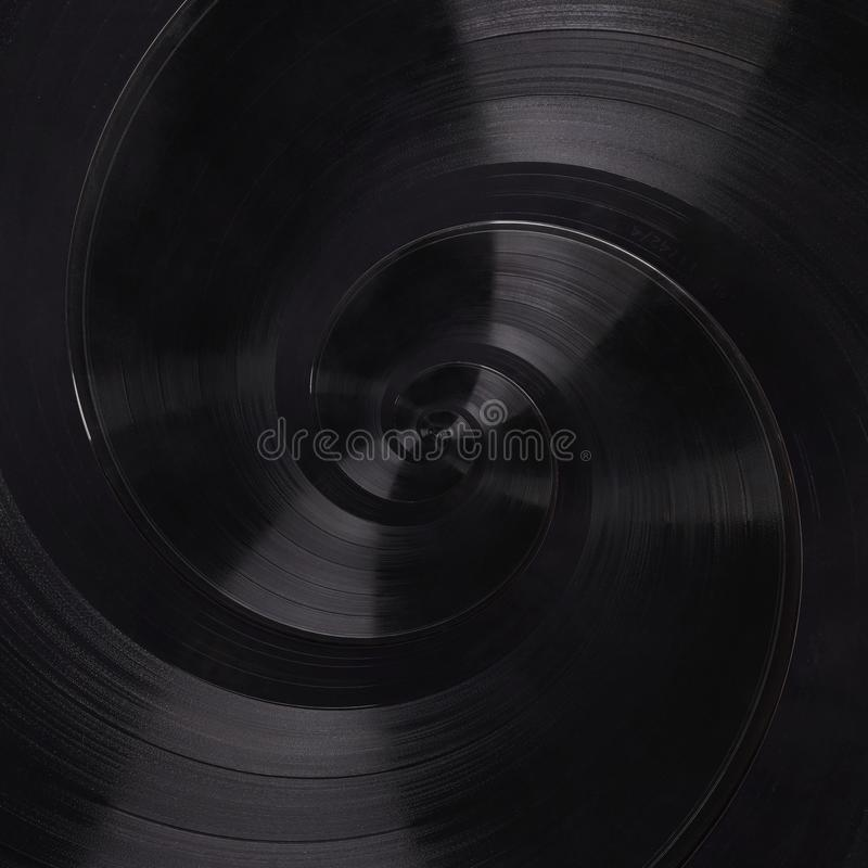 Abstract music vinyl disc spiral fractal background. Retro music vinyl disc abstract fractal. Vintage musical conceptual image. Pattern background Repetitive royalty free stock photo