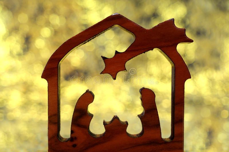 Abstract nativity. Abstract wooden carved nativity scene with golden background stock images