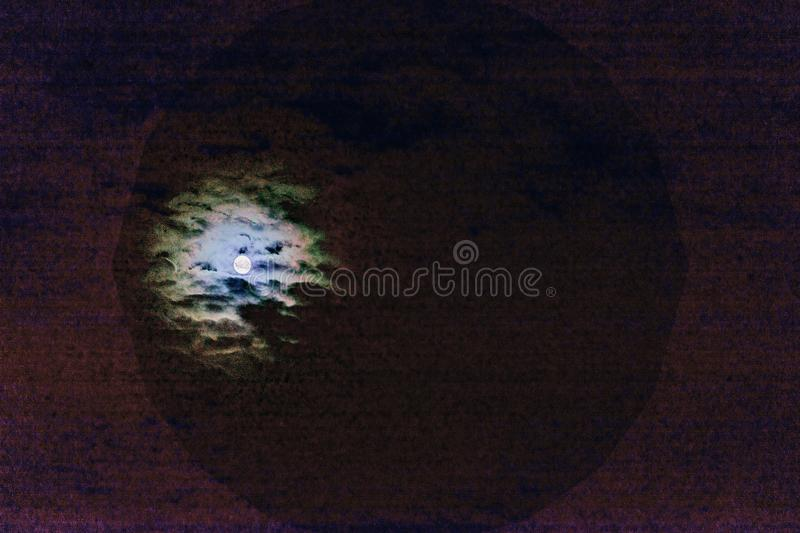 Abstract Natural scary Halloween background, full moon, dark purple cloudy sky, bright double super moon. Vintage royalty free stock image