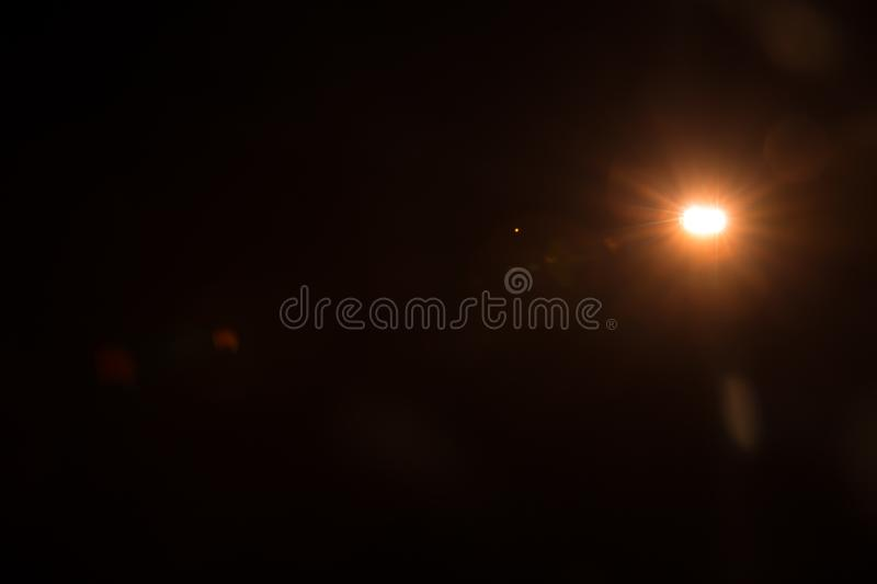 Abstract Natural Sun flare on the black. Background stock photo