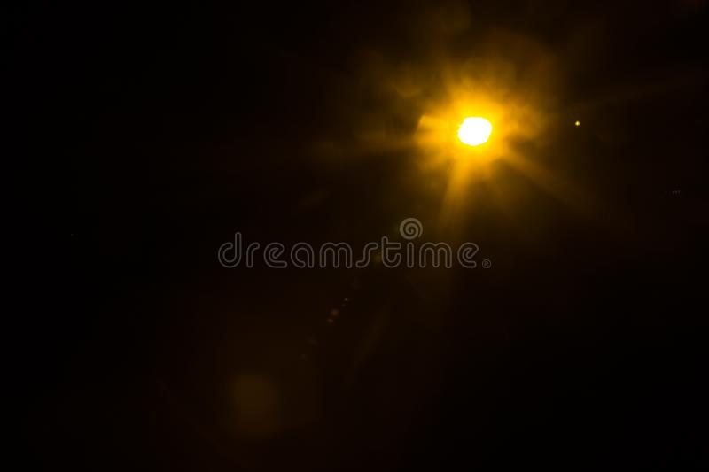Abstract Natural Sun flare on the black. Background royalty free stock image