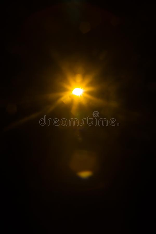 Abstract Natural Sun flare on the black. Background royalty free stock photography