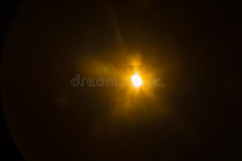 Abstract Natural Sun flare on the black. Background stock photography