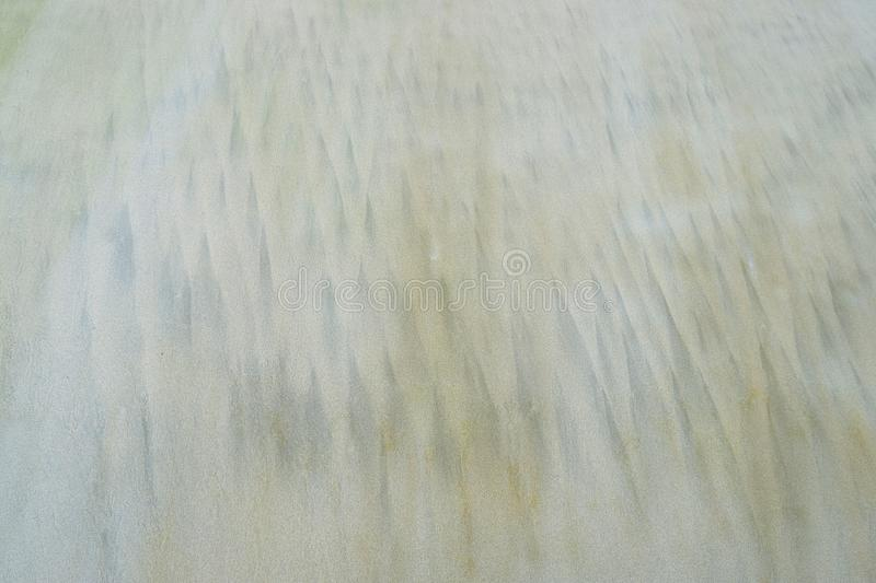 Abstract Natural Texture Background - Lines, Shapes, and Triangles on Sandy Beach royalty free stock image