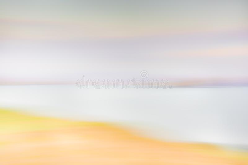 Abstract nature background - blurred sunset sky, purple clouds, mountains, ocean stock photo