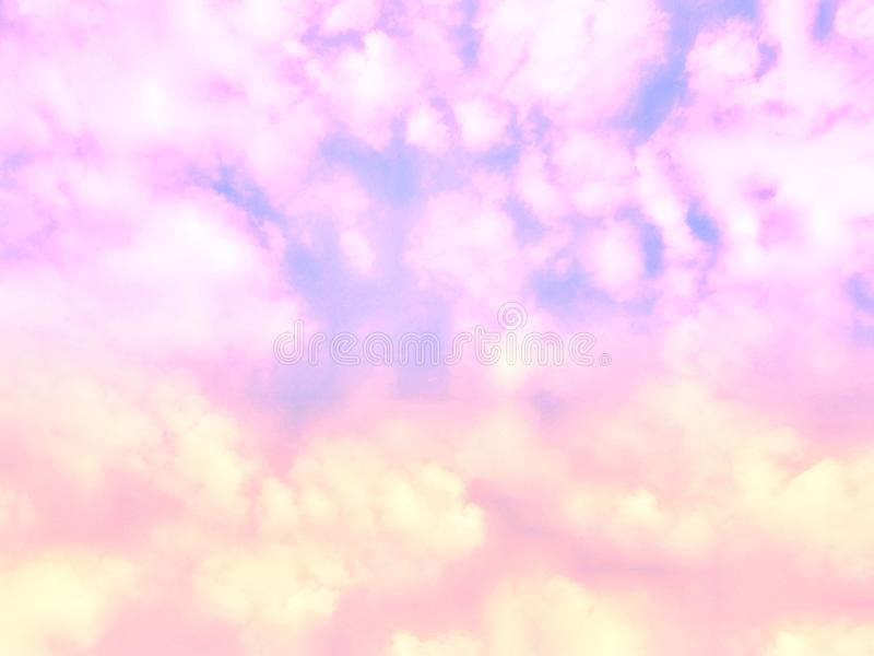 Abstract nature background of colorful pastel puffy & fluffy soft clouds on beautiful vivid & vibrant blue sky in morning sunlight stock photo