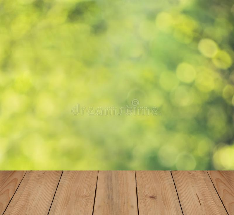 Abstract Nature Background. With Summer Soft Focus Bokeh Light and Empty Wooden Board with Copy space stock image
