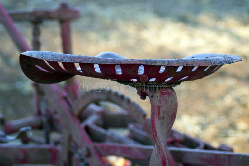 Abstract neem de uitstekende zetel van landbouwbedrijfmachines over royalty-vrije stock fotografie