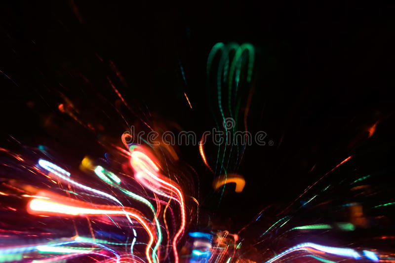 Abstract neon sparks. Abstract multicolored neon sparks in motion photo background effect stock photo