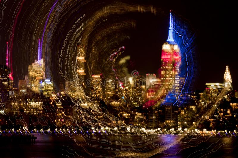 New York City abstract. Abstract of New York City skyline with in camera spin effect. Picture taken during 9-11 memorial tribute stock photography