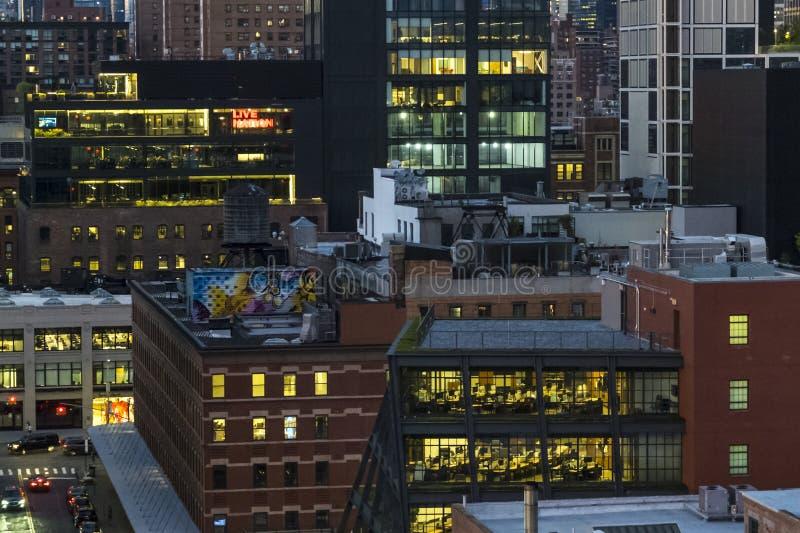 Abstract Night scene Manhattan with illuminated windows. stock images