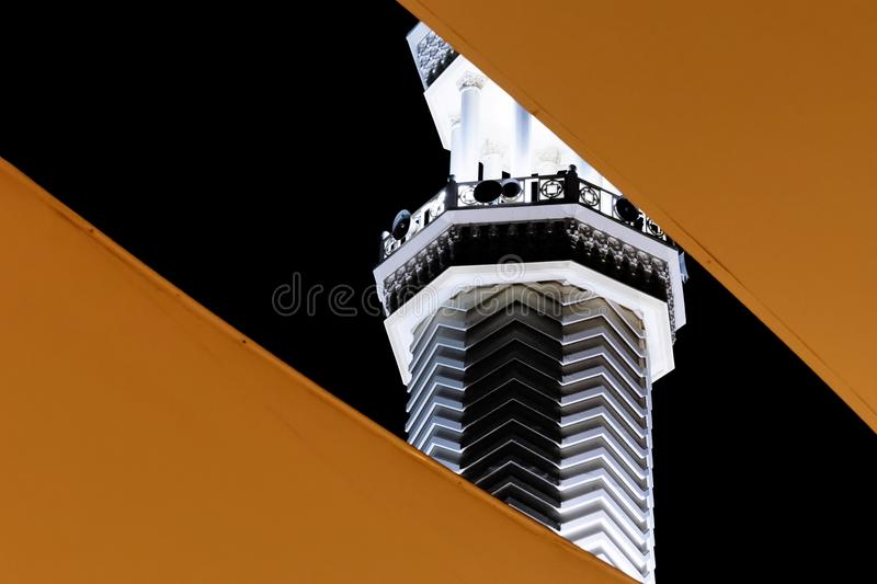 Abstract night view of the minaret of Sharif Hussein bin Ali Mosque, the central mosque in Aqaba, Jordan stock image