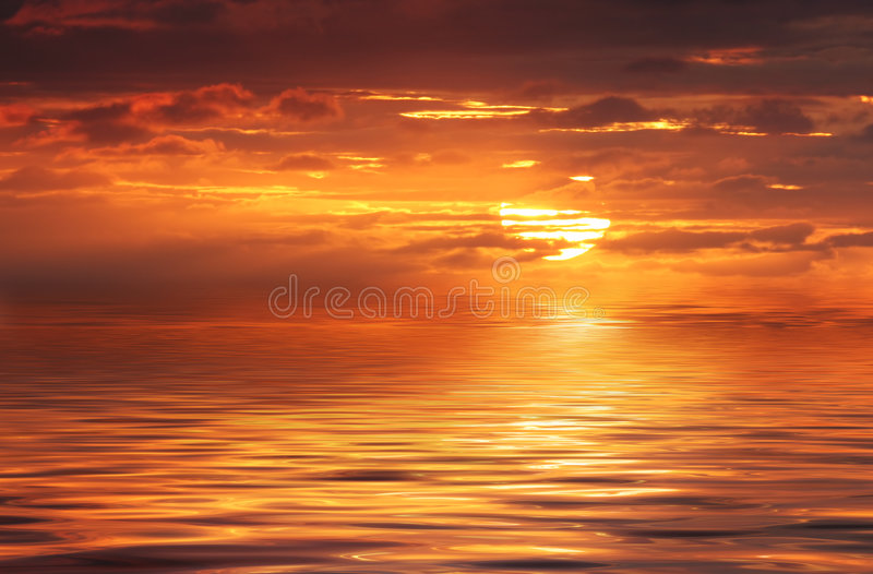 Abstract Ocean and Sunrise. Abstract ocean and glorious golden sunrise royalty free stock photography
