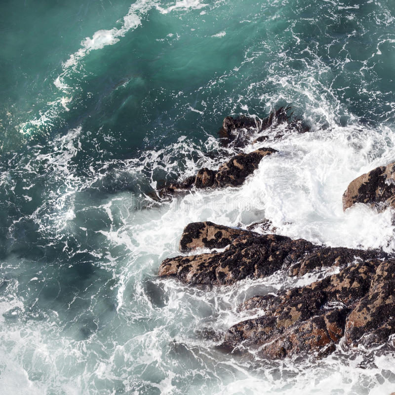 Abstract ocean surf on cliffs royalty free stock photo