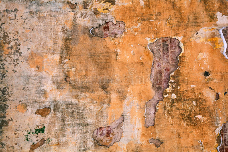 Abstract old background with grunge texture. Old paint falling off the wall. Completely peeling walls abandoned buildings - a dirty background stock photography