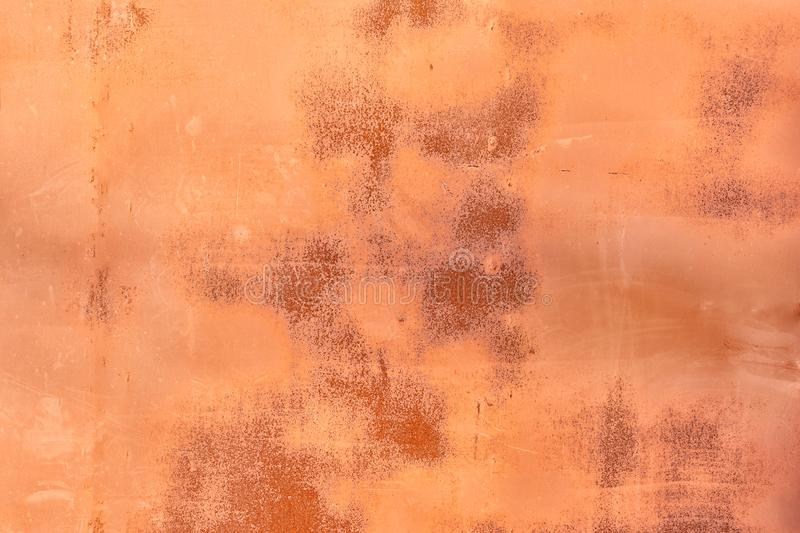 Abstract orange background for layout. Old metal sheet with cracked paint, scratches and rust stains. stock images