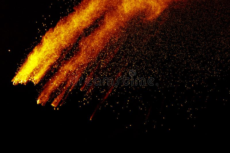 Abstract orange dust explosion on black background. royalty free stock photography