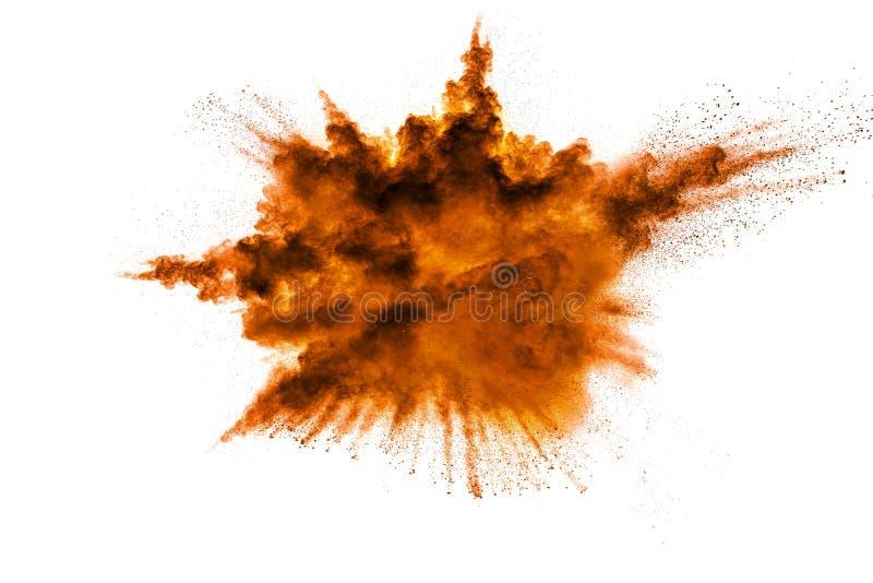 Abstract orange powder explosion on white background. Abstract orange dust splattered on clear background. Freeze motion of orange powder splash. Painted Holi stock photo