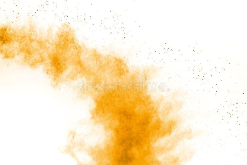 Abstract orange powder explosion on white background.Freeze motion of orange dust splash.  royalty free stock images