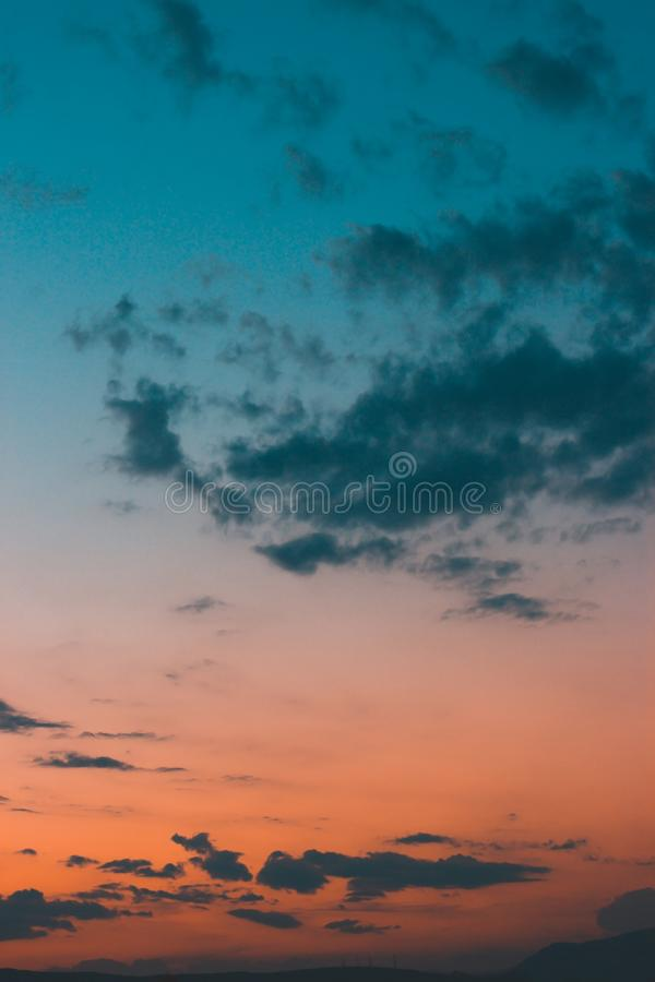 Abstract orange - teal sky. Sunset background stock images