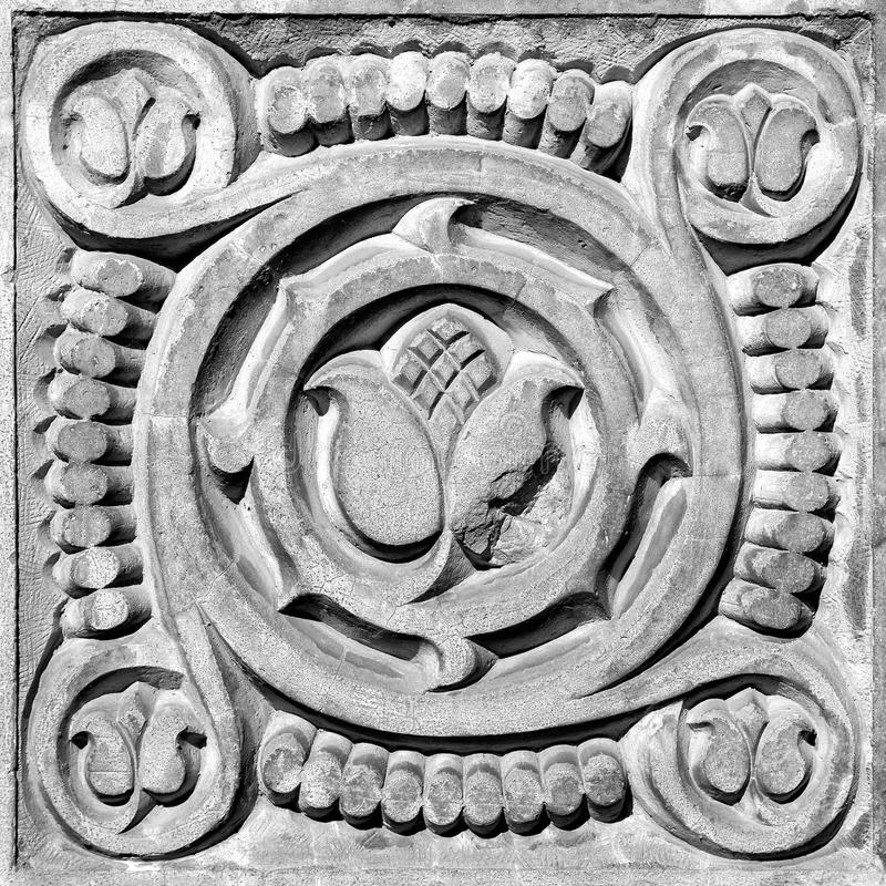 Abstract ornament, bas-relief. Abstract ornament, a stone bas-relief on the wall stock photo