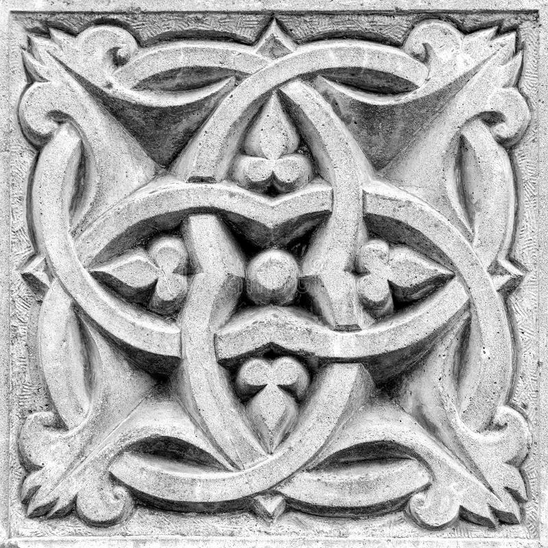 Abstract ornament, bas-relief. Abstract ornament, a stone bas-relief on the wall stock image