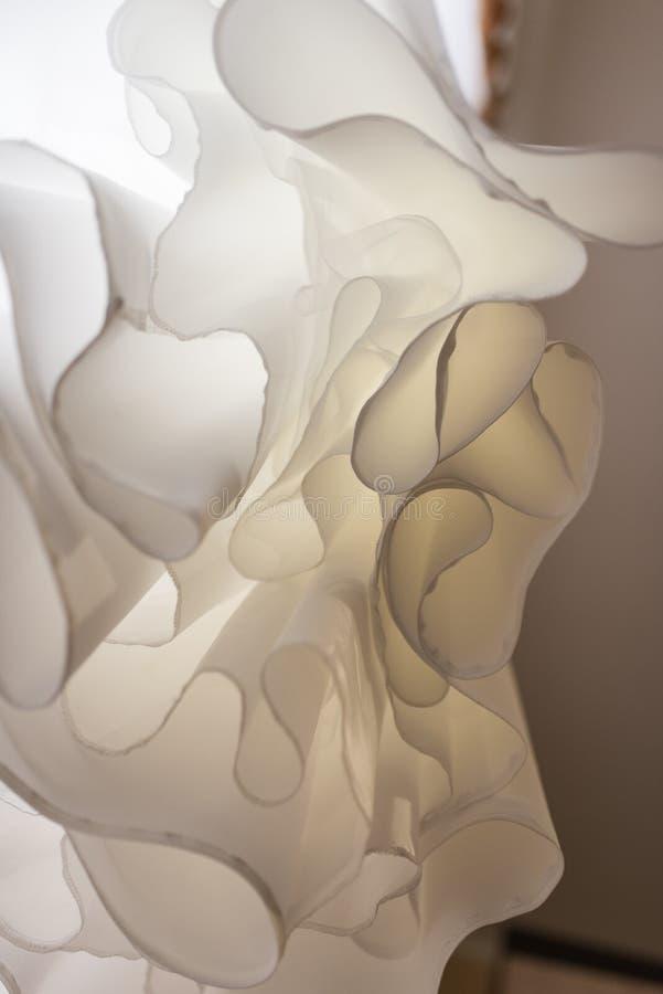 Abstract overhang wedding dress. unusual upward angle view. Dress stock photo