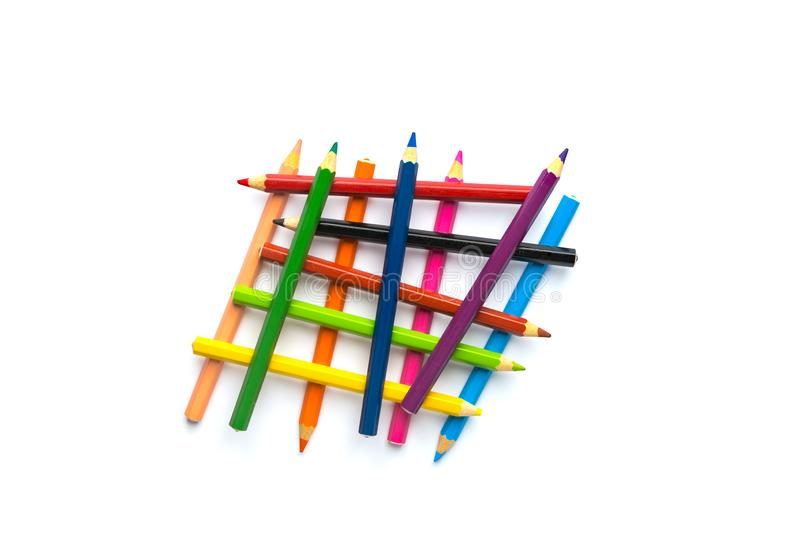 Abstract overlapping construction from multicolored pencils on white background. Business ideas concept innovation teamwork stock photo