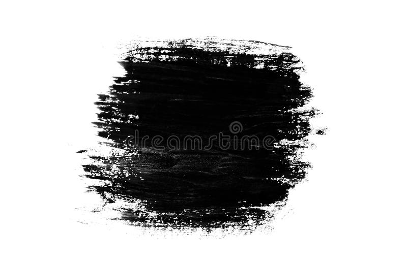 Abstract paint brush stroke. Black brush stroke over textured white paper background royalty free stock photo