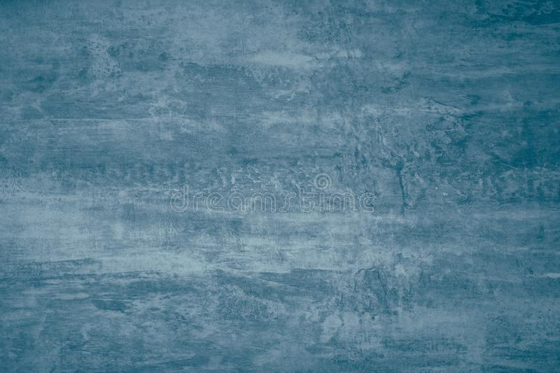 Abstract paint pattern on dark blue gray background. Blue paint stains on canvas. Illustration with blots on dark grey background. Creative artistic backdrop stock photo