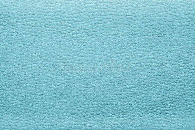 Abstract painted textures of skin turquoise color. Abstract background from the painted texture of skin and leather fabric turquoise color stock images