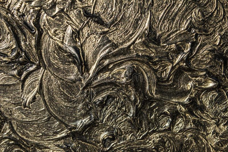 Abstract painting on canvas. Black colors and gold. Background. Abstract painting on canvas. Black colors and gold. Abstract patterns. Background stock photography
