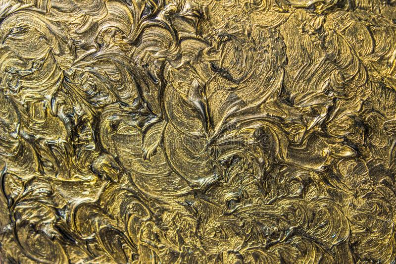 Abstract painting on canvas. Black colors and gold. Background. royalty free stock image