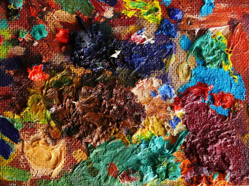 An abstract painting of their chaos of colors on the cardboard. Bright abstract painting of their chaotically thrown paint on cardboard stock images