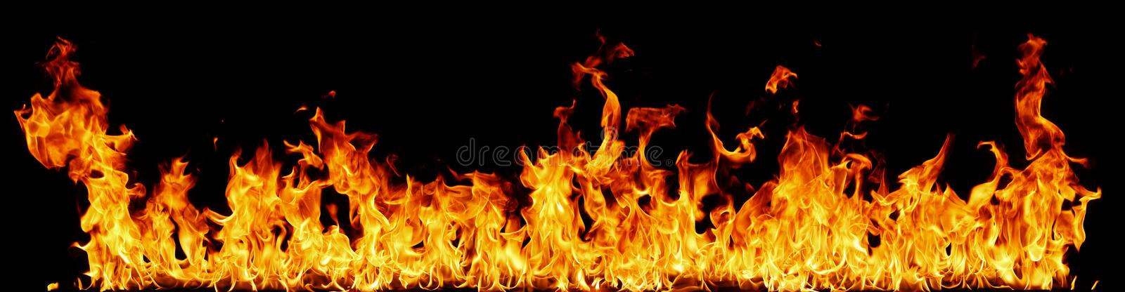 Abstract panoramic border of fire. Panoramic abstract background of burning red fire flames on black stock photo