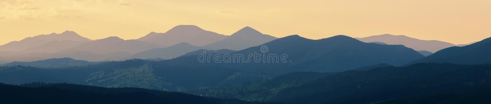 Abstract panoramic mountain landscape, tonal perspective at suns stock photography