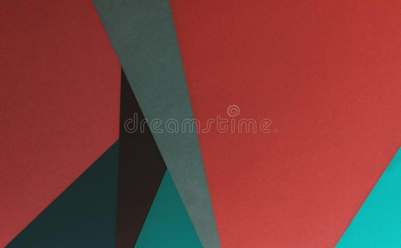 Abstract paper art craft background. Shapes with muted darker tones stock photo