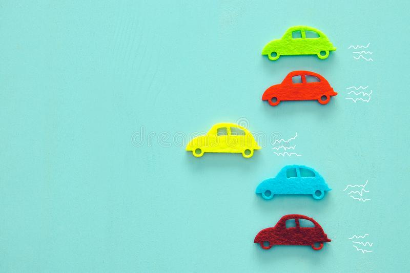 Abstract pastel colored wooden background with vibrant car shapes. Abstract pastel colored wooden background with vibrant car shapes royalty free stock image