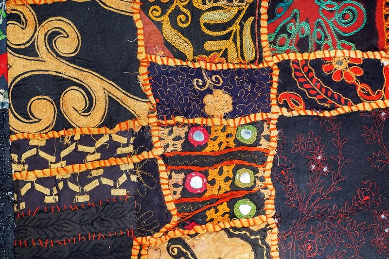 Abstract patchwork background. Colorful handmade vintage details and patterns on texture of old blanket. stock photography