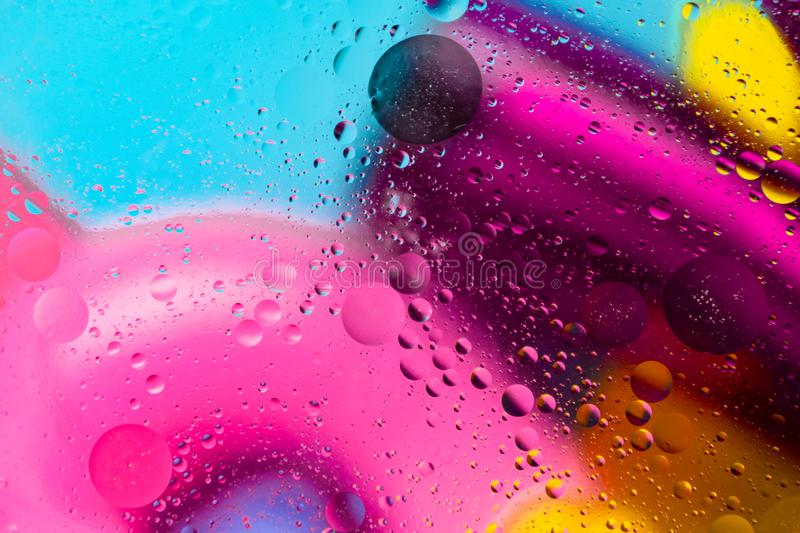 Micro molecular abstract pattern of colored oil bubbles on water. royalty free stock photo