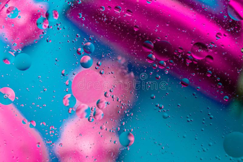 Micro molecular abstract pattern of colored oil bubbles on water. royalty free stock images