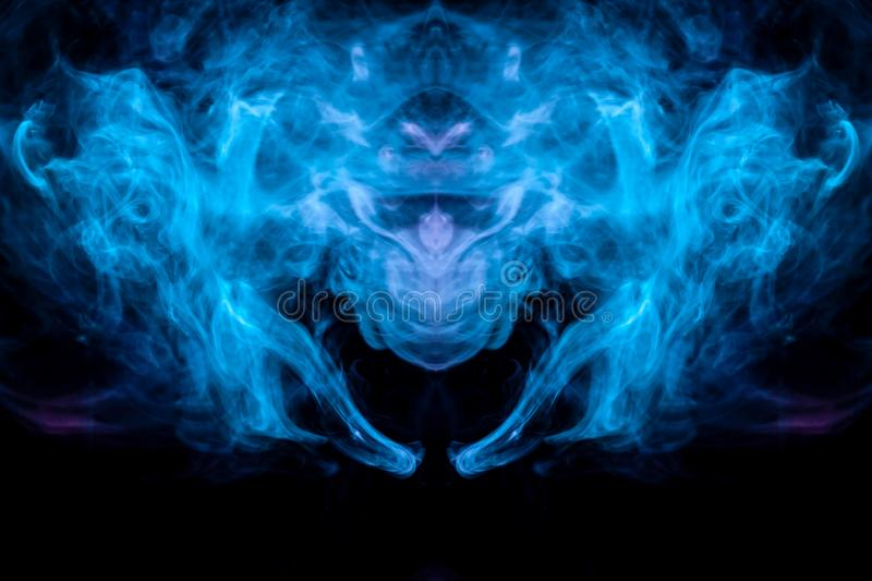 Abstract pattern of colored smoke backlit blue and turquoise takes the form of the head of a mystical creature with wings on a royalty free illustration