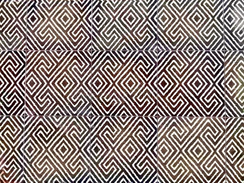 Abstract pattern design selective focus of decorative tile to laminate on the floor. royalty free stock images