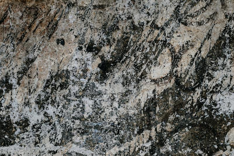Abstract pattern on gray concrete texture. Dark stone background. Vintage close-up of black and white marble. Granite background m stock images