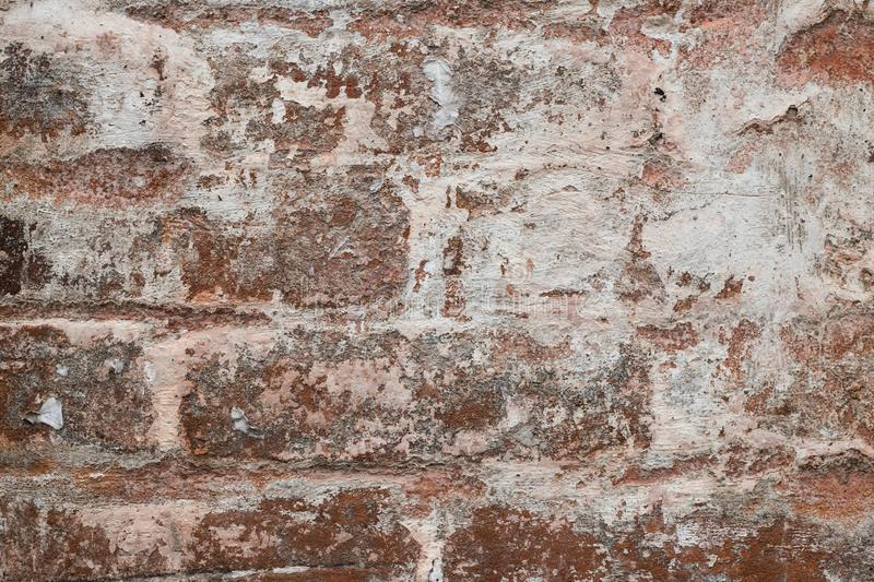 Abstract pattern on light brown stucco backdrop. Texture of old dilapidated wall. Urban grunge texture background. Vintage plaster royalty free stock photography