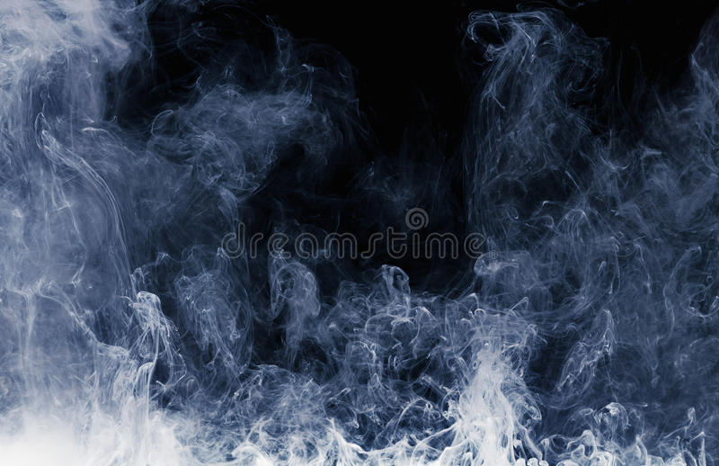 Abstract pattern of white smoke on a black background. Waves of mist and clouds. Abstract pattern of Billowing white smoke on a black background. Waves of mist stock images