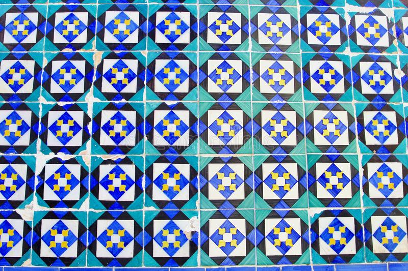Abstract patterns old Portuguese tiles white blue turquoise. Abstract patterns and decoartions of old Portuguese tiles in blue, white, yellow and turquoise at a stock photo
