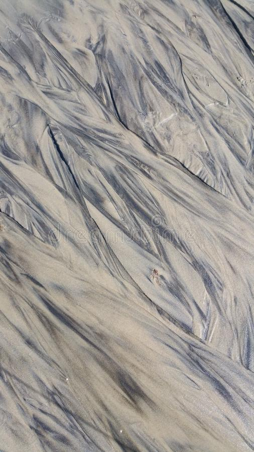 Abstract patterns in the sand on the beach at Martha`s Vineyard Massachusetts USA stock images