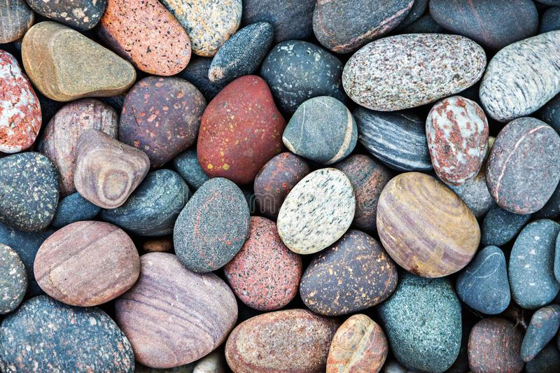 Abstract pebble stones background. Abstract nature background with colorful pebble stones royalty free stock images